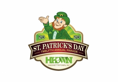 Leprechaun waving for Hackettstown's St. Patrick's Day parade