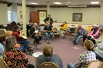 People playing musical instruments and singing at Hope Hootenanny