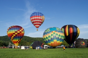 Hot air balloons inflating and rising into the skies over Warren County, New Jersey.