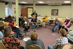 People playing musical instruments and singing at Hope Hootenanny